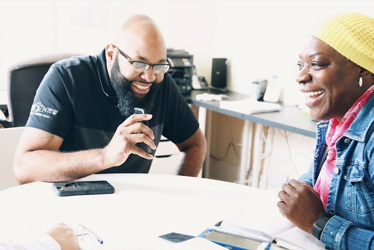 Laughing with Clients while discussing projects
